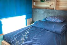 Queen bed with window @ XV Homestay