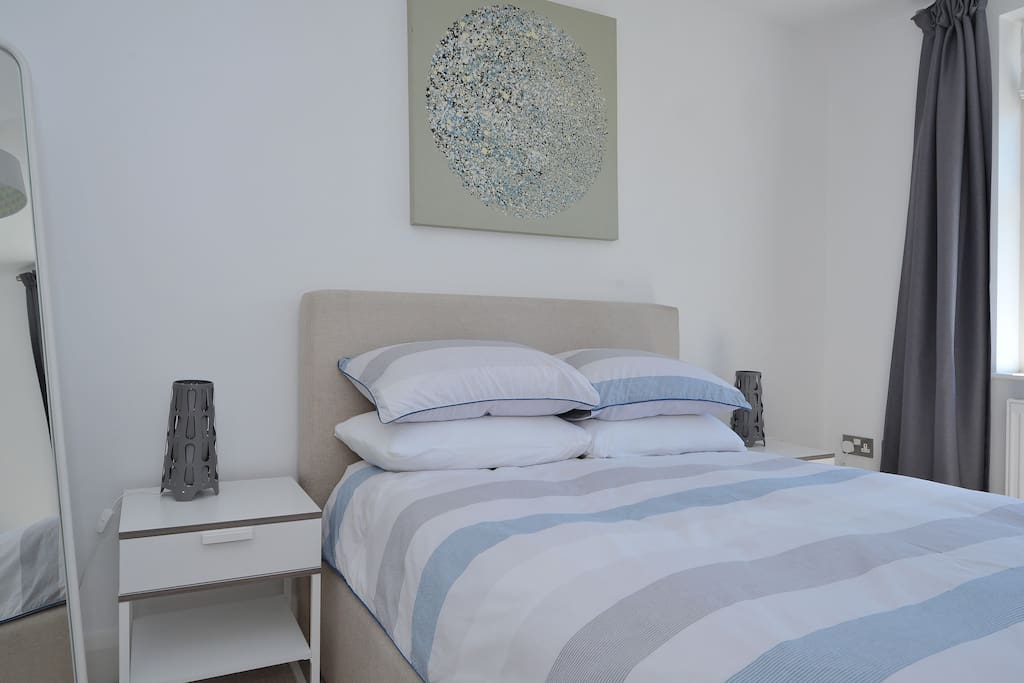 Guest bedroom with comfortable double sized bed.