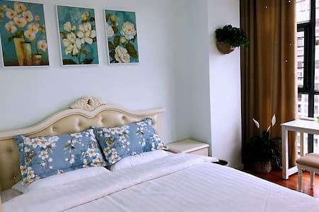 安顺市安卓公寓欧式田园大床房核心商圈附近好吃街和火车站悦居