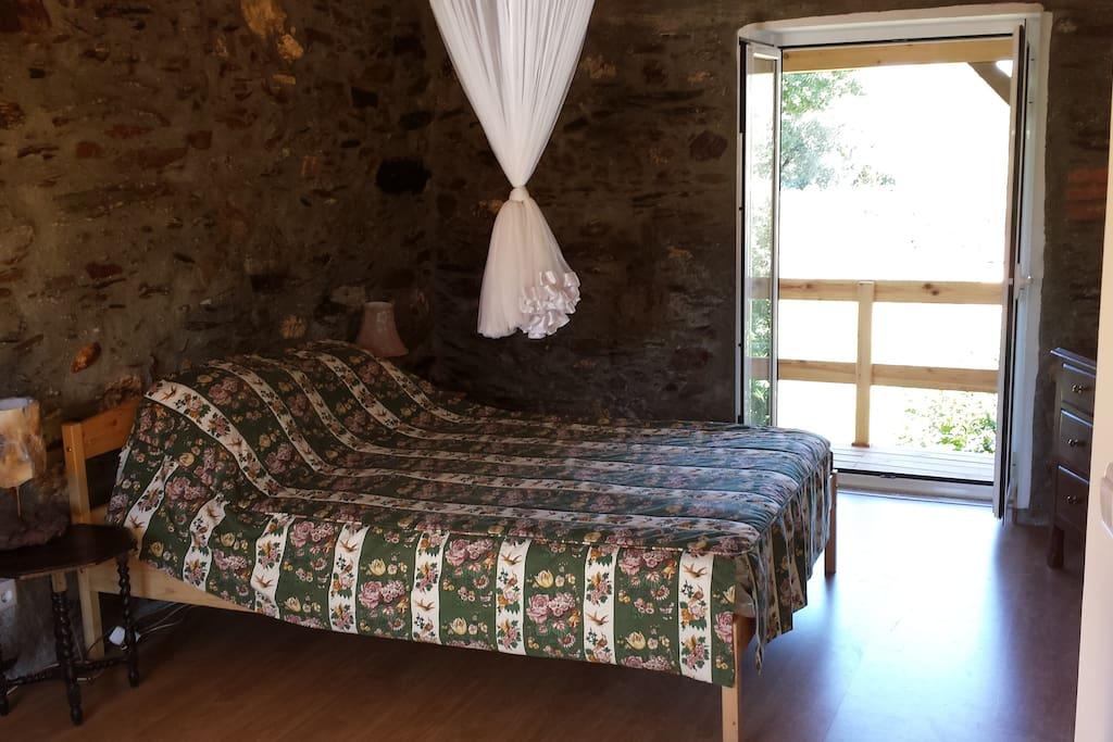 bedroom 1 with french doors to veranda