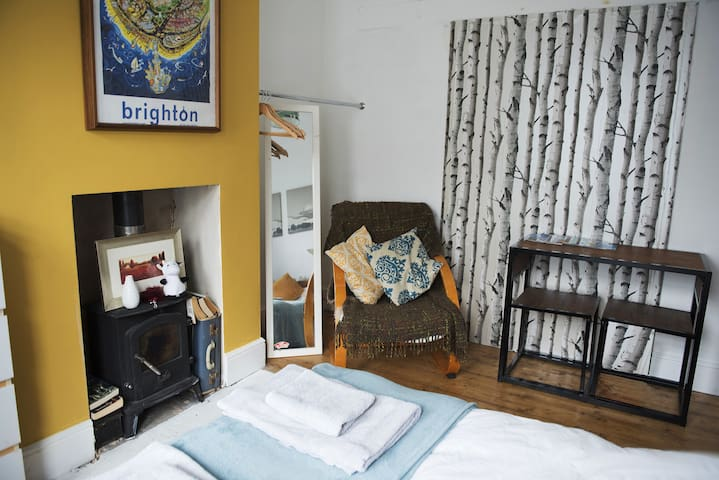 Your room with small table, rail for clothes, chair