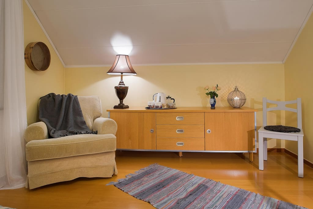 Relax corner of main bedroom. Enough space to add 1-2 extra beds for young kids who want to stay in same room as parents