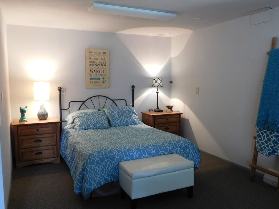Queen bed with drawer space in night stands for guests.