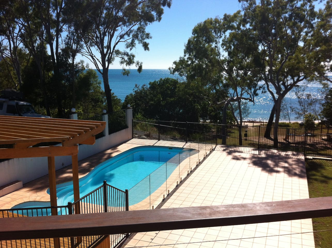 Large enclosed pool with raised deck. Tiled and grassed yard area