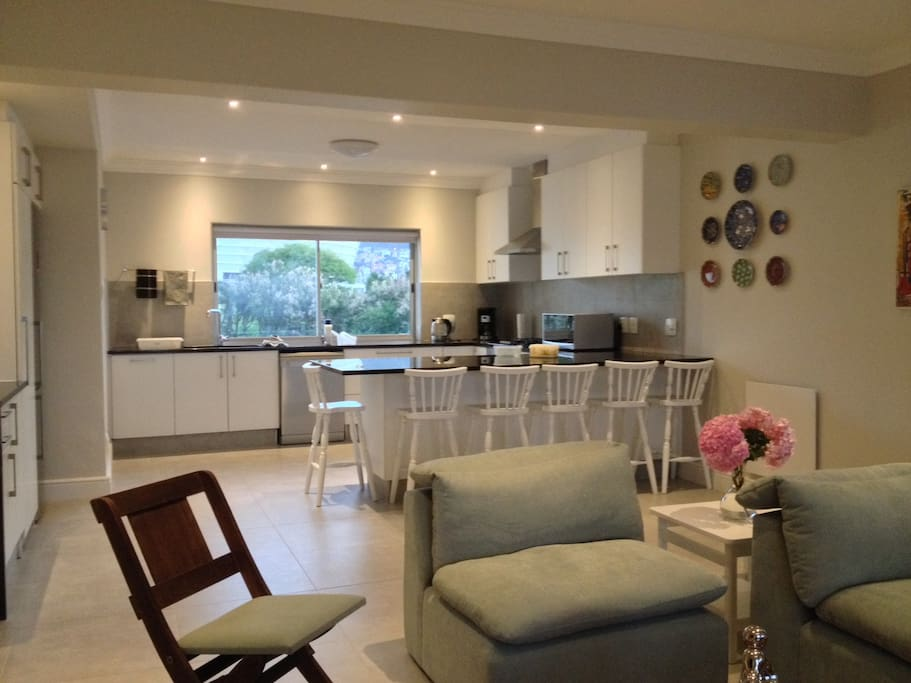 Lounge and open plan kitchen with view of golf course and stadium