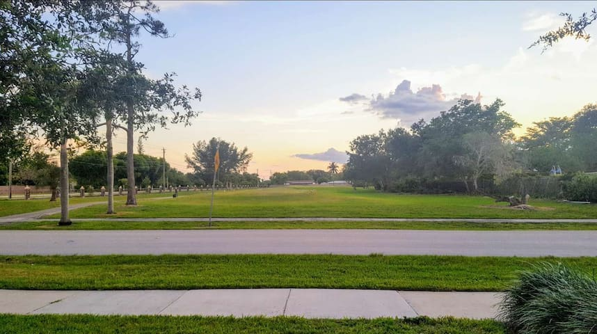 Front view. Golf Course and nice sidewalks for walk, jog or run.