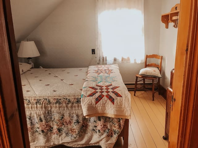 Second Bedroom. Double bed and dresser with mirror