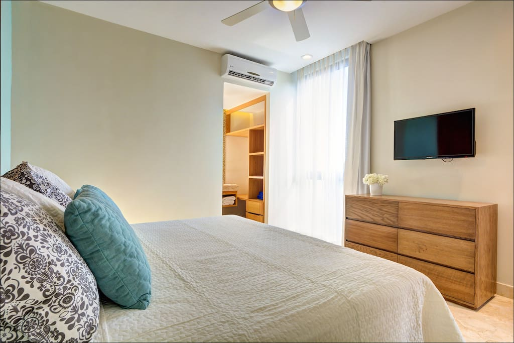 Comfortable kingsize bed with built in cabinets & TV