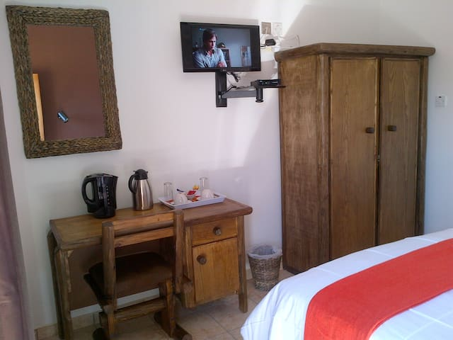 TV and desk in room. Free WIFI available.