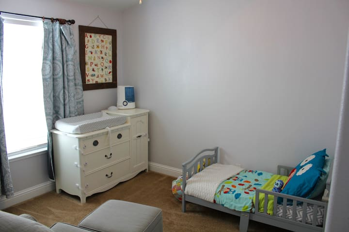 Toddler Bedroom available for use by young children, equipped with a video baby monitor and sound machine.