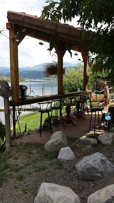 relax at the outdoor bar while taking in the scenic view