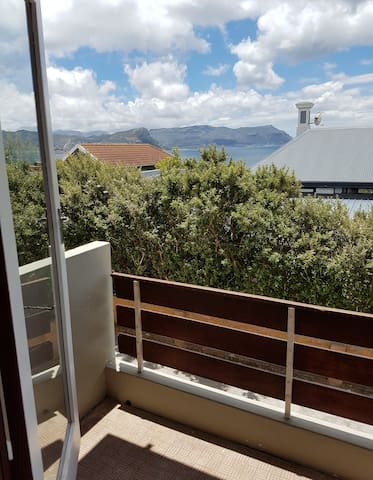 Balcony with mountain and sea views