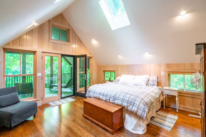 Master bedroom with king bed and attached upper level porch (not screened in)