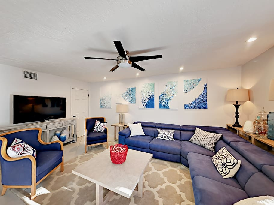 Gather the group in the comfortable living room, offering plenty of seating.