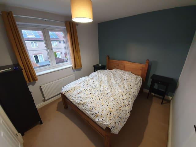 Bedroom photo taken from door. Brand new double bed.