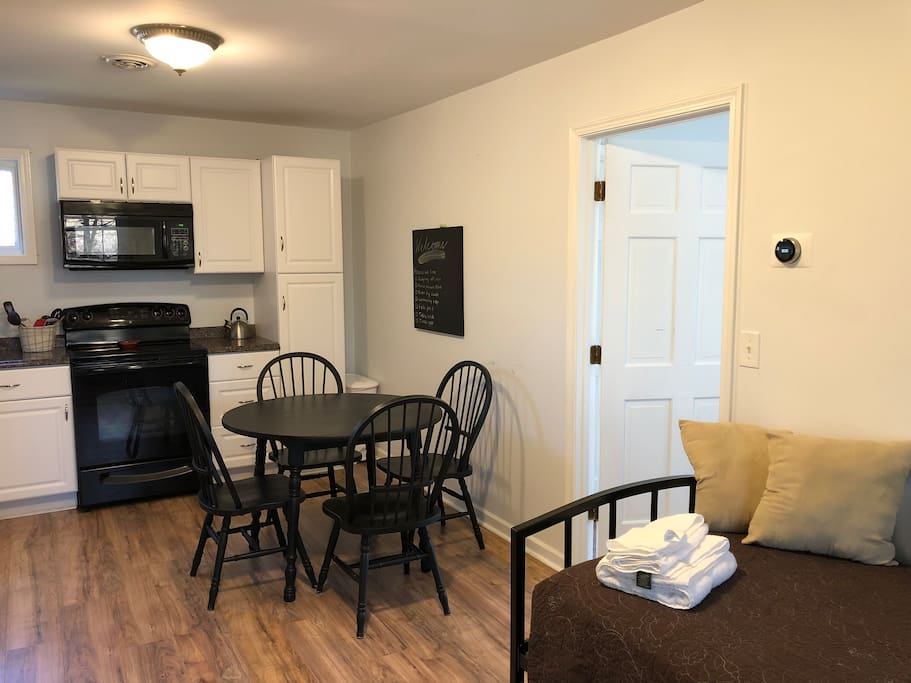The space features a full dine-in kitchen with cookware, bakeware, and seating for four. The Nest thermostat helps keep temperatures comfortable, while a Nest carbon monoxide and smoke detector connected to the main house gives peace of mind