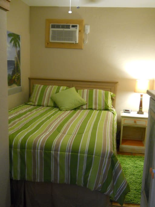 Private bedroom with Queen bed, nightstand, small closet & dresser