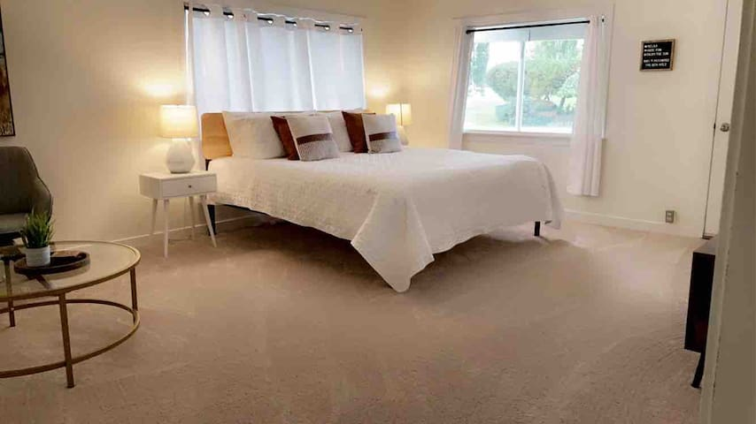 """*Butler Cabin* Bedroom on basement level. King bed with 10"""" memory foam mattress, sitting area, table, private entrance from back yard, and Roku TV."""