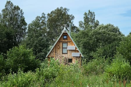 Solar-powered riverside eco-cabin close to the sea