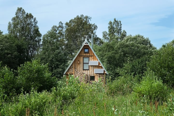Solar-powered riverside eco-cabin and sauna