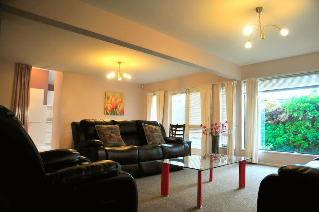Lounge with comfy sofas, big TV, dining area, to outside area and kitchen