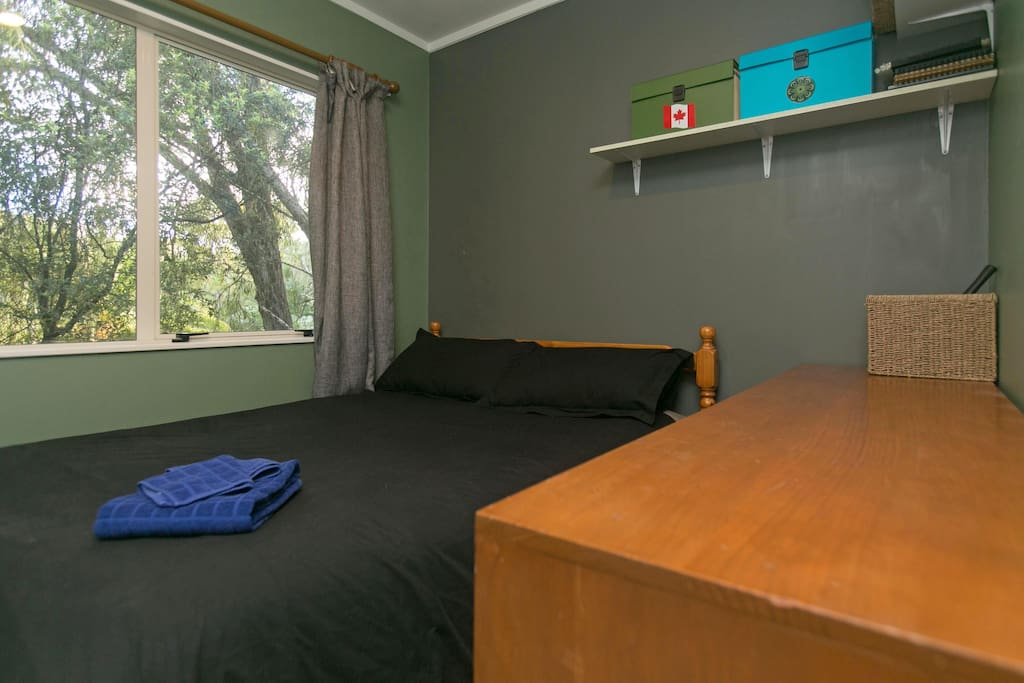 Double bed in small room, no drawers nor closet space