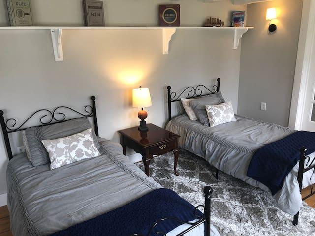 Bedroom #1: Twin Beds. 1st floor.  Doors on bedroom for privacy.