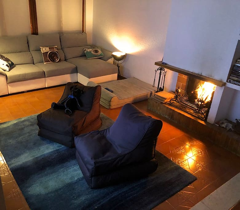 Spacious living room with fireplace, 2 armchairs and sofa, with HD TV. The perfect place to spend an evening with a glass of wine.