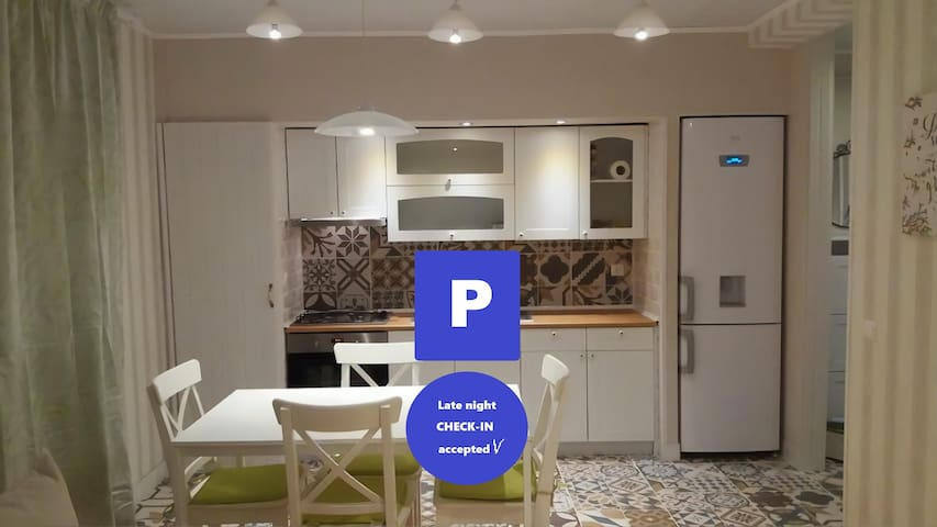 White cozy apartment with free private parking