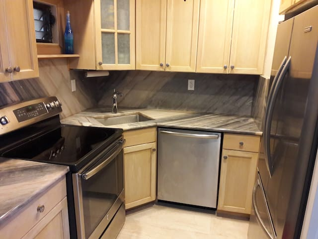 Granite countertops and full-size appliances.
