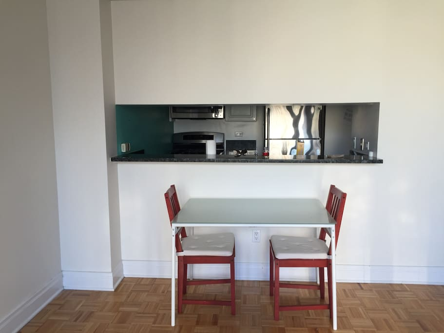 Pass-through kitchen with table and 2 chairs