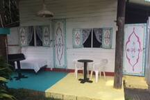 another 2 bedrooms cottage plus attached bathrooms cottage with 2 hammocks
