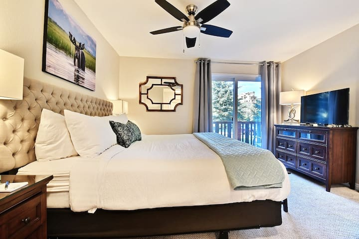King Master Bedroom with luxurious linens, 2 closets, HDTV, back deck and stream views.
