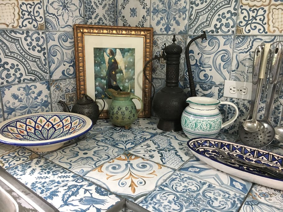 Old Spanish /Moroccan tiles design throughout kitchen.