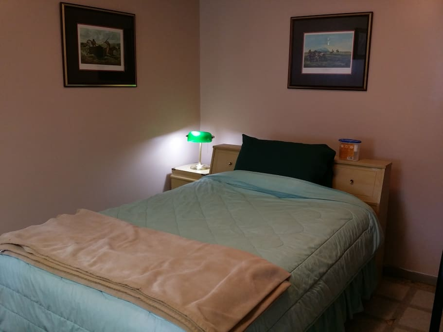 double bed with light and storage