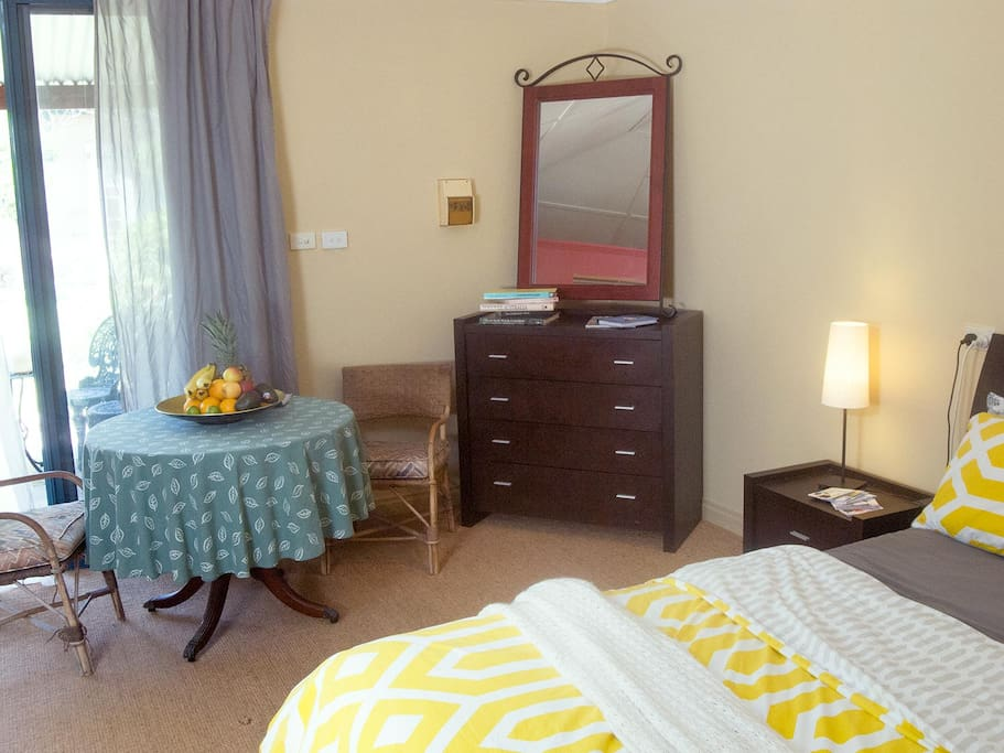 Light filled and spacious room with Queen bed and dining table