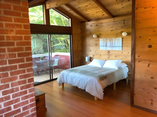 Master suite includes: balcony with view of Tomales Bay,  workspace and full bath