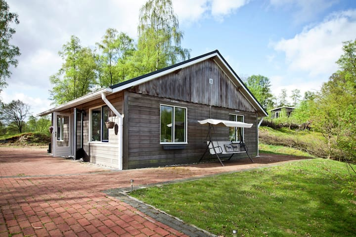 Detached chalet on a large plot with view of a lake