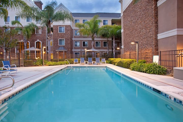 Equipped Suite with Pool Access | Free Breakfast, Shuttle + Fitness Center Access