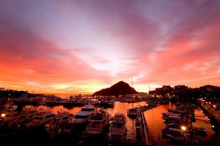"This beautifully remodeled,fully furnished studio is located in the heart of Cabo San Lucas and overlooks the Marina. Save money on a car,Walk to the world famous ""Medano Beach"" or take a  water taxi to the ""Cabo San Lucas Arch"" both in just 5 min."