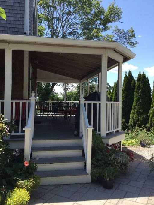 Wraparound porch large enough for outdoor dining.