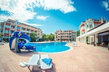 Pool with kid safe area, life guard, restaurant, shop and slide