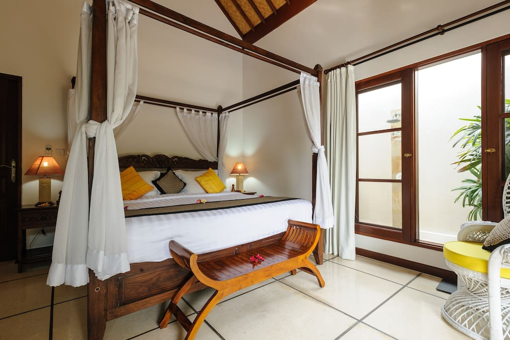 King Bedroom. This bedroom features a spacious ensuite (with indoor shower & bath), outdoor shower, a beautiful traditional balinese ceiling with fans & A/C to keep you cool on those warm Bali nights. This bedroom is definitely fit for royalty!