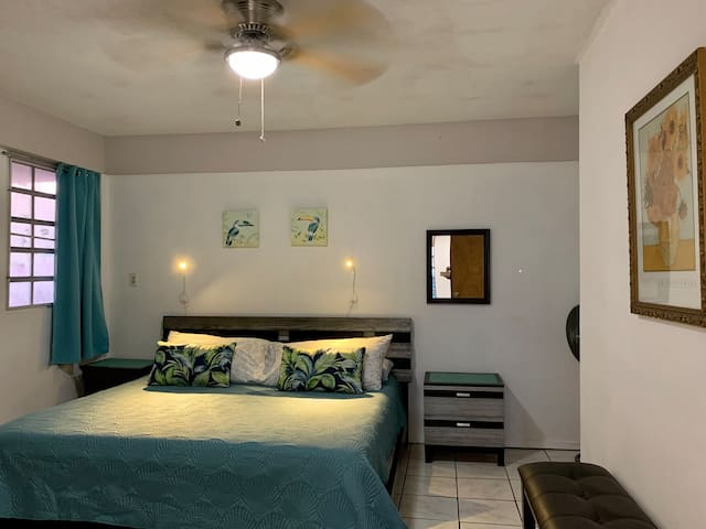 Comfortable & Spacious KING-SIZE Bed with Reading Lights in Large Air Conditioned Bedroom.
