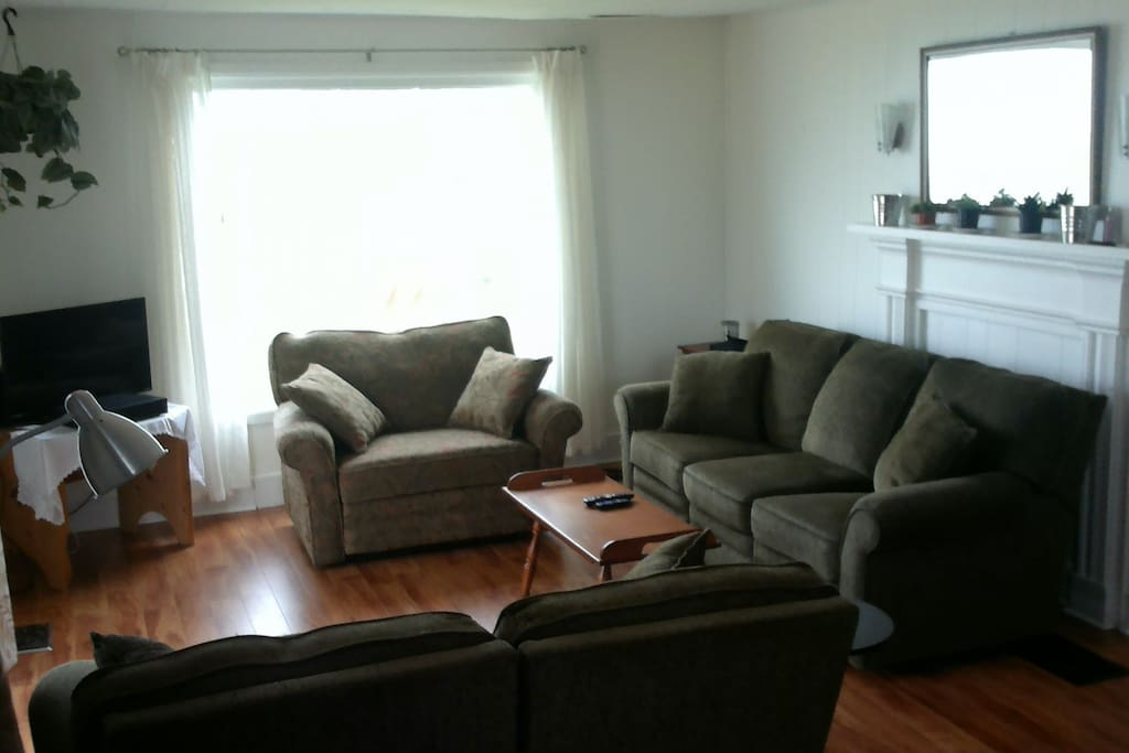 Family room with cable television and stunning views of the bay of Fundy