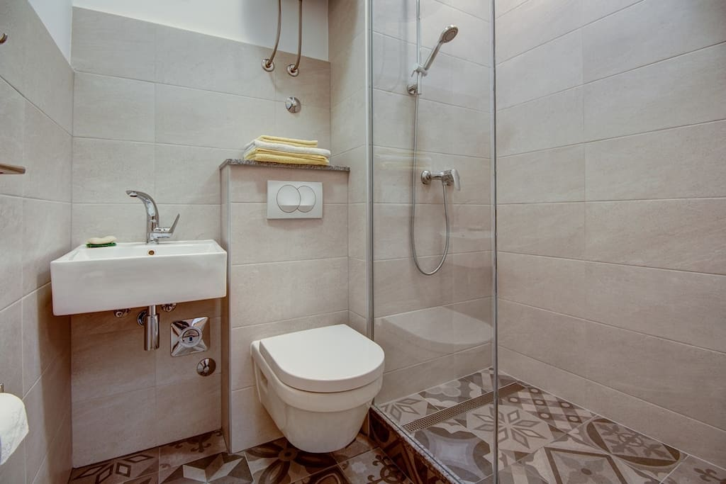 The bathroom is linked to your room.