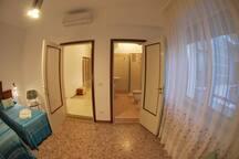 camera doppia letti singoli, bagno in camera, tv, wifi, aria condizionata/riscaldamento
