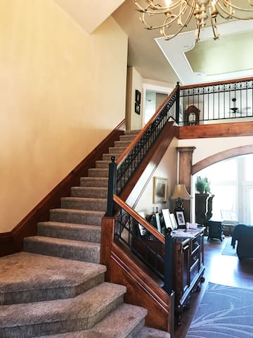 Staircase off Front door leading to room on the left