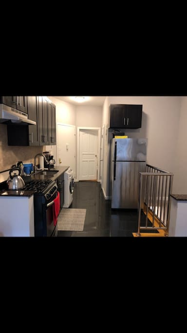 Open Kitchen with Dishwasher and Laundry machine.