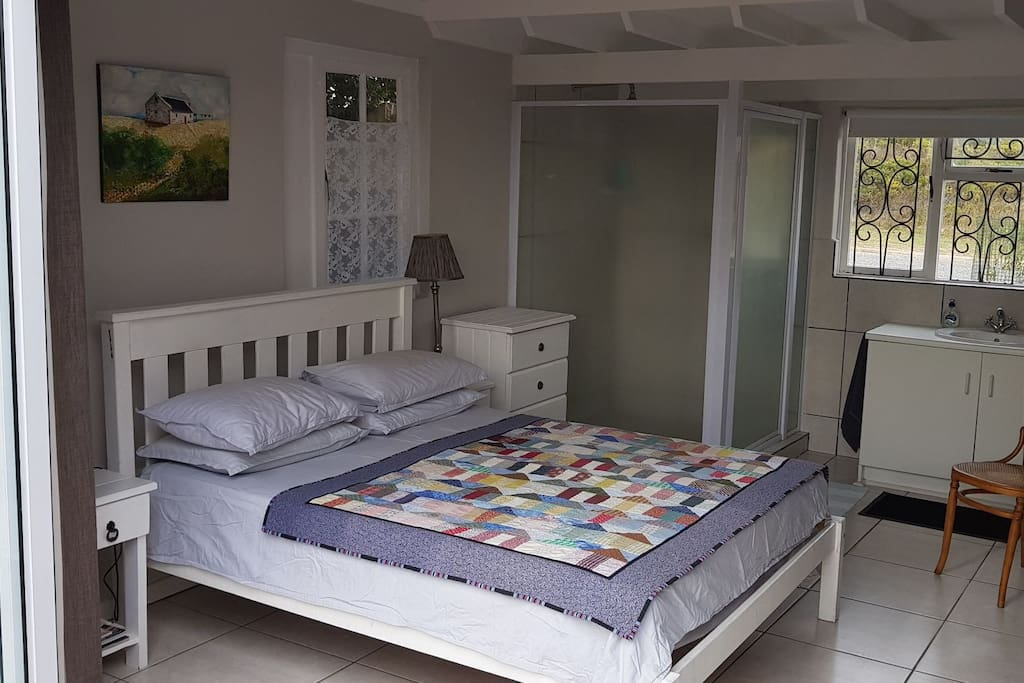 Queen size double bed and lovely big shower.